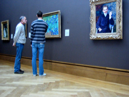 visitors in front of Irises by van Gogh